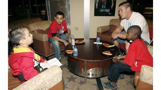 Oscar, Martin and Avery meet John Cena in Houston in November 2008.