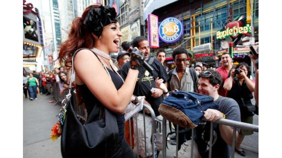 Maria greets the WWE Universe in New York City's Times Square.