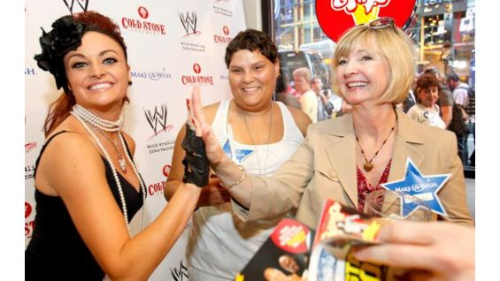 Make-A-Wish Foundation representative, Gail, high-fives Maria.