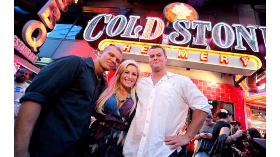 Tyson Kidd, Natalya and David Hart Smith pose outside Cold Stone Creamery.