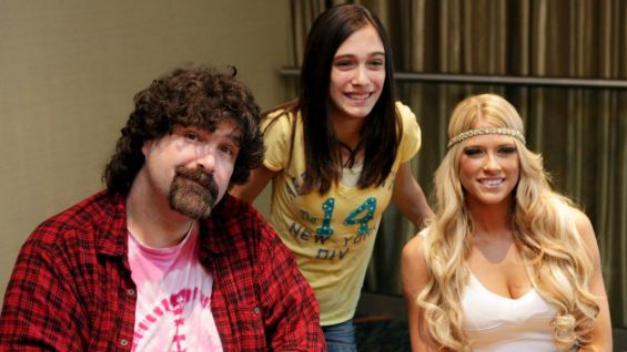 Bestselling author Mick Foley and former Divas Champion Kelly Kelly pose with one of the WrestleMania Reading Challenge finalists.