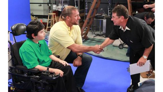 "Triple H is part of the MDA ""Make A Muscle, Make A Difference"" campaign."
