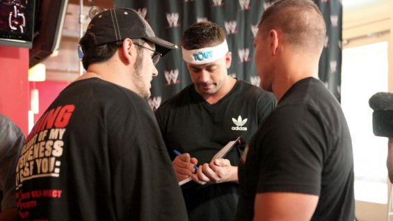 Alex Riley and Tyson Kidd sign autographs for the WWE Circle of Champions honorees and their families.