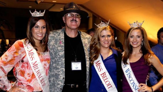 Sports stars, business executives and celebrities - including Wisconsin beauty queens - attend the Muscle Team benefit.