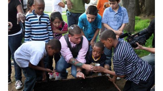 Mathews and the children help make the world a greener place.
