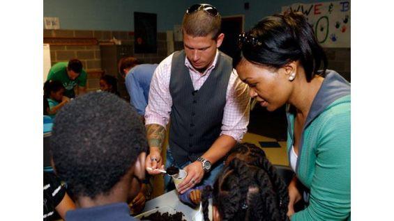 WWE NXT announcer Josh Mathews lends a hand during Earth Day.