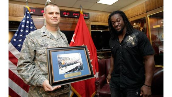 John Cena is displayed on a plaque honoring WWE's Tribute to the Troops.