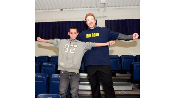 Sheamus shows off his new Mill Road School shirt.