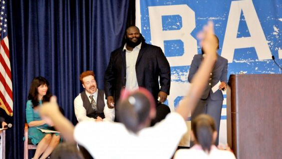 The hundreds of students are excited to see The World's Strongest Man and give him a standing ovation.