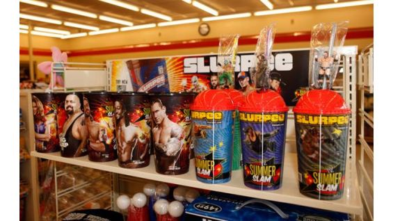 The 7-Eleven SummerSlam Big Gulp and Slurpee cups are on display.