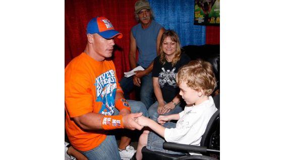 John Cena says hello to 7-year-old Eeron Almond.