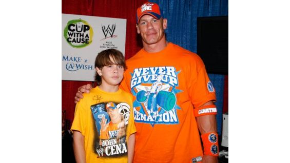 Robert poses for photos with Cena before Raw in Kansas City.