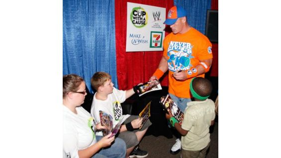Cena gives WWE programs to the boys and their families.