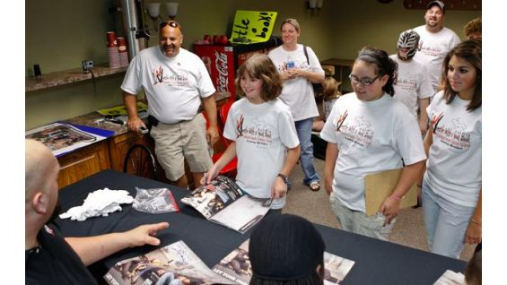 The Superstars signed autographs before SmackDown in Detroit.