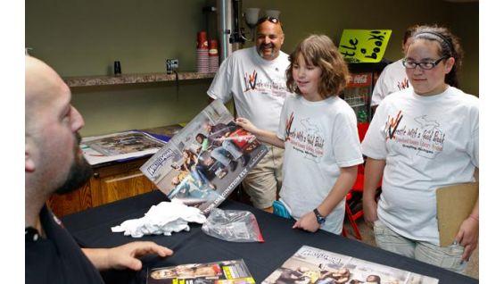 Haley Kovefus, 10, asks Big Show for an autograph.