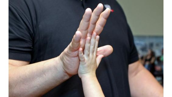 Big Show compares hand sizes with the 7-year-old WWE fan.
