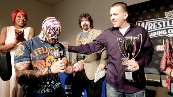 Grade 9-12 winner Jesus Reyes came from behind to score the victory, and shares a moment with WWE's Ultimate Underdog Rey Mysterio.