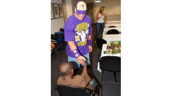 Ronald Young greets his favorite WWE Superstar with a handshake.