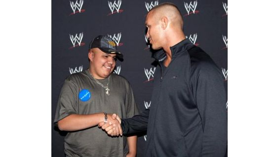 David smiles while meeting his favorite WWE Superstar before seeing Raw.