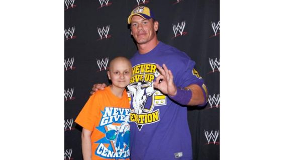 Lee poses for a photo with Cena before Raw.