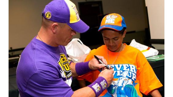 Manuel Ramos gets an autograph from his favorite WWE Superstar.