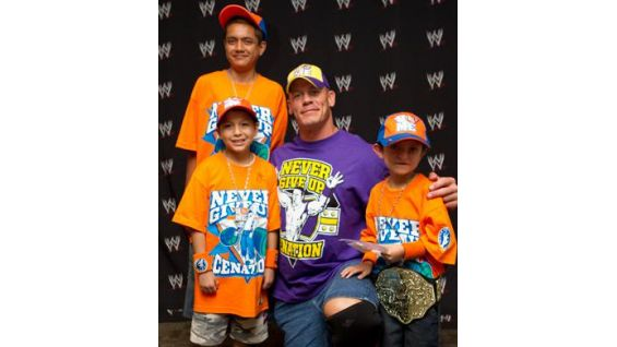 Cena poses with three of his biggest fans.