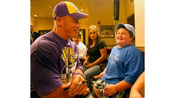 Chris Ames shares a laugh with Cena.