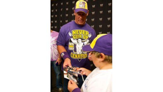 The Make-A-Wish Ambassador signs several autographs for Austin.