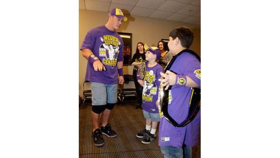 Jesse Lucas, center, and Shayan Shams, both 9, say hello to Cena.
