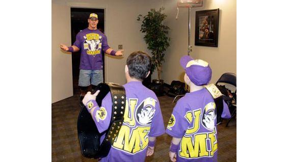 John Cena greets the latest Circle of Champions honorees.