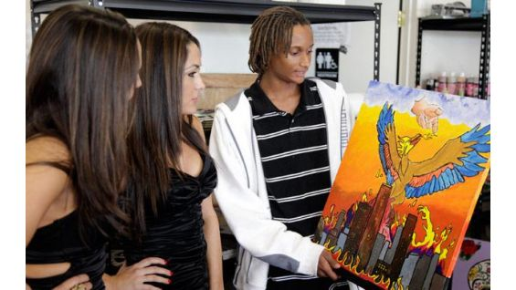 The twins look at teens' artwork at YMCA Las Artes de Maricopa County.