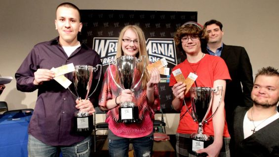 Winners Reyes, Nicole Jones and Chase Leclair show off their trophies and WrestleMania XXVIII ringside seats.