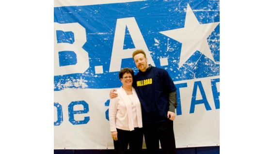 Mill Road school principal Erika Forte smiles with Sheamus.