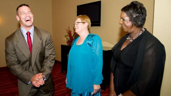 Cena shares a laugh with wish mom Judith Harrison and Christina Harrison.