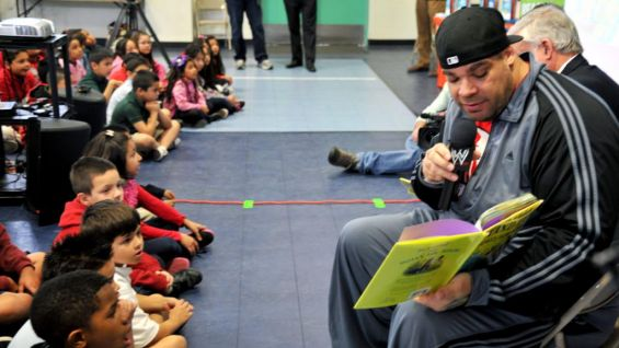 "Brodus Clay reads from ""Stand Tall, Molly Lou Melon."""