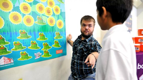 Hornswoggle particpates in a classroom activity with one of the students.