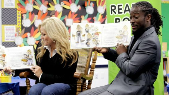 Natalya and Intercontinental Champion Kofi Kingston read to the second-graders.
