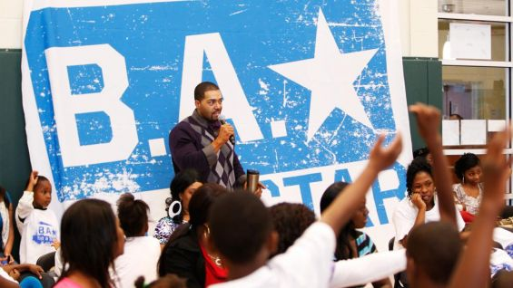 Dozens of children raise their hands to ask the Superstar questions.