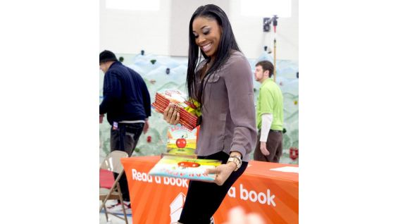 Each student receives a book from the Brodus and The Funkadactyls.