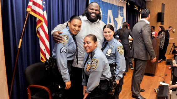 Mark Henry meets a few school safety officers after the rally.
