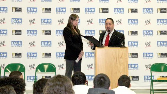 Rep. Andres Ayala Jr. presents WWE Executive Vice President of Creative Stephanie McMahon with a citation for the be a STAR Alliance's diligent work towards ending bullying.