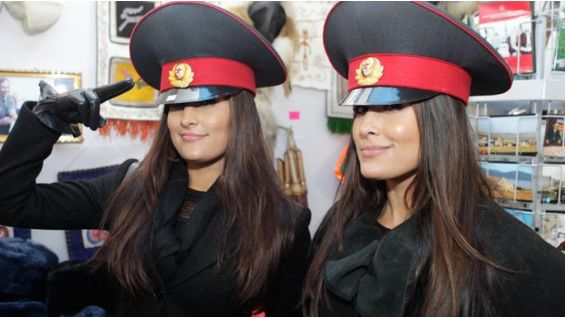 The Bellas show off their authentic Kyrgyzstan general army hats.