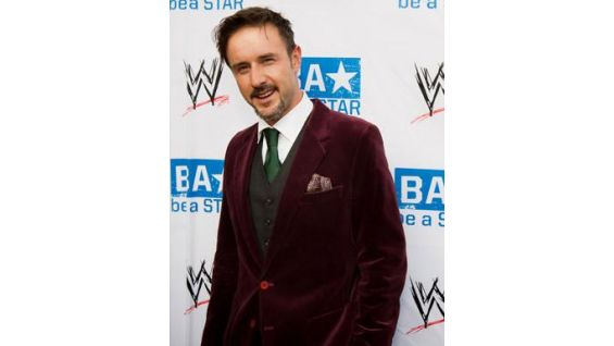Actor David Arquette poses on the red carpet.