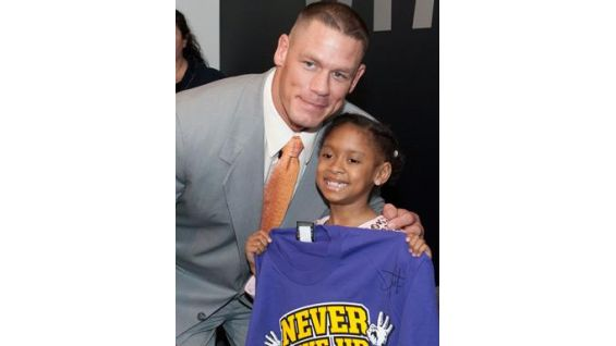 Cena gave the children some of his latest merchandise from WWEShop.com.