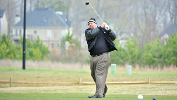 The World's Largest Golfer, Big Show, takes a drive.