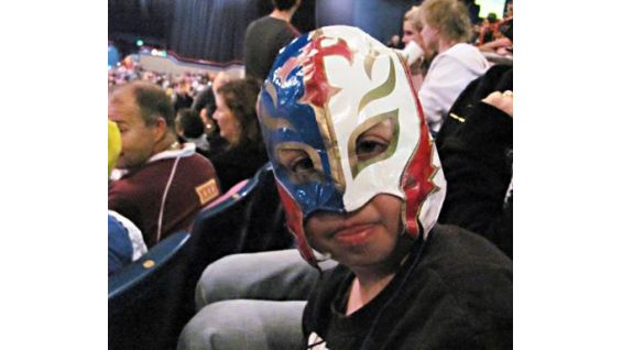 Joshua of Starlight Children's Foundation dresses as Rey Mysterio for a WWE event in Australia.