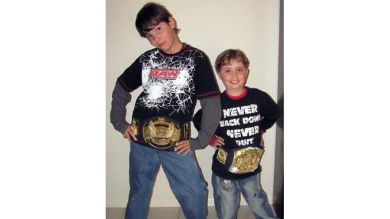 Joshua and his brother show off their WWE gear after the Brisbane show.