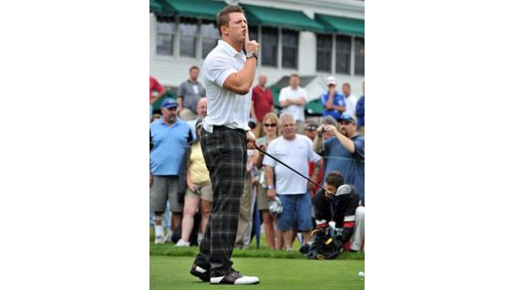 The WWE Superstar hushes the crowd at the Travelers Championship Pro-Am.