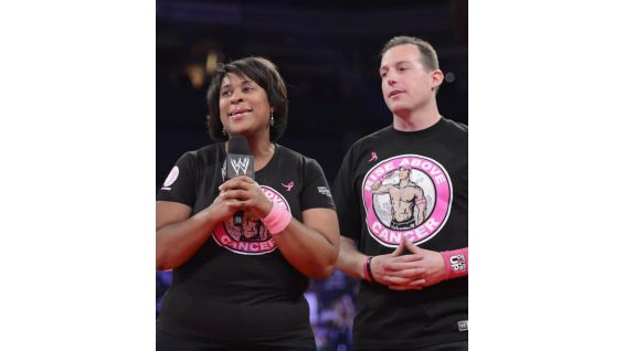 Dorothy Jones, Vice President of Marketing for Susan G. Komen, and  Eric Brinker, son of Susan G. Komen Founder/CEO Nancy G. Brinker thank the WWE Universe.