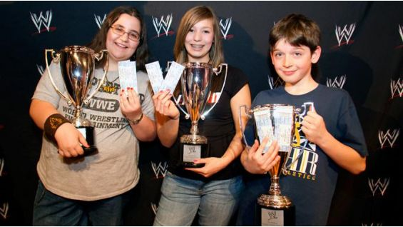 The winners show off their ringside tickets to WrestleMania XXVII!